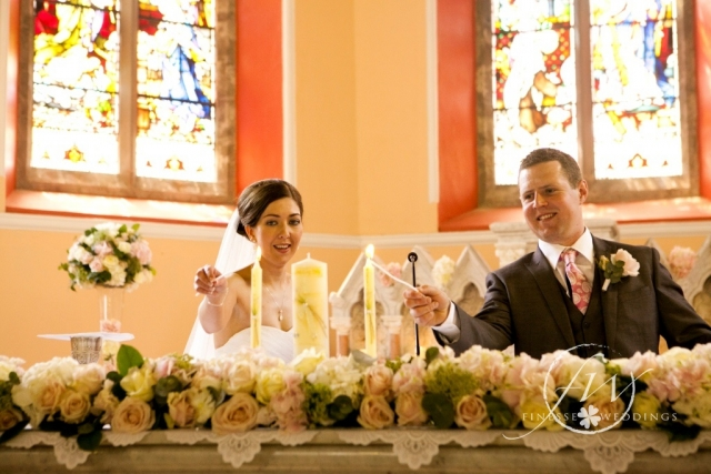 Bride and groom at the alter - flowers by Finesse Weddings