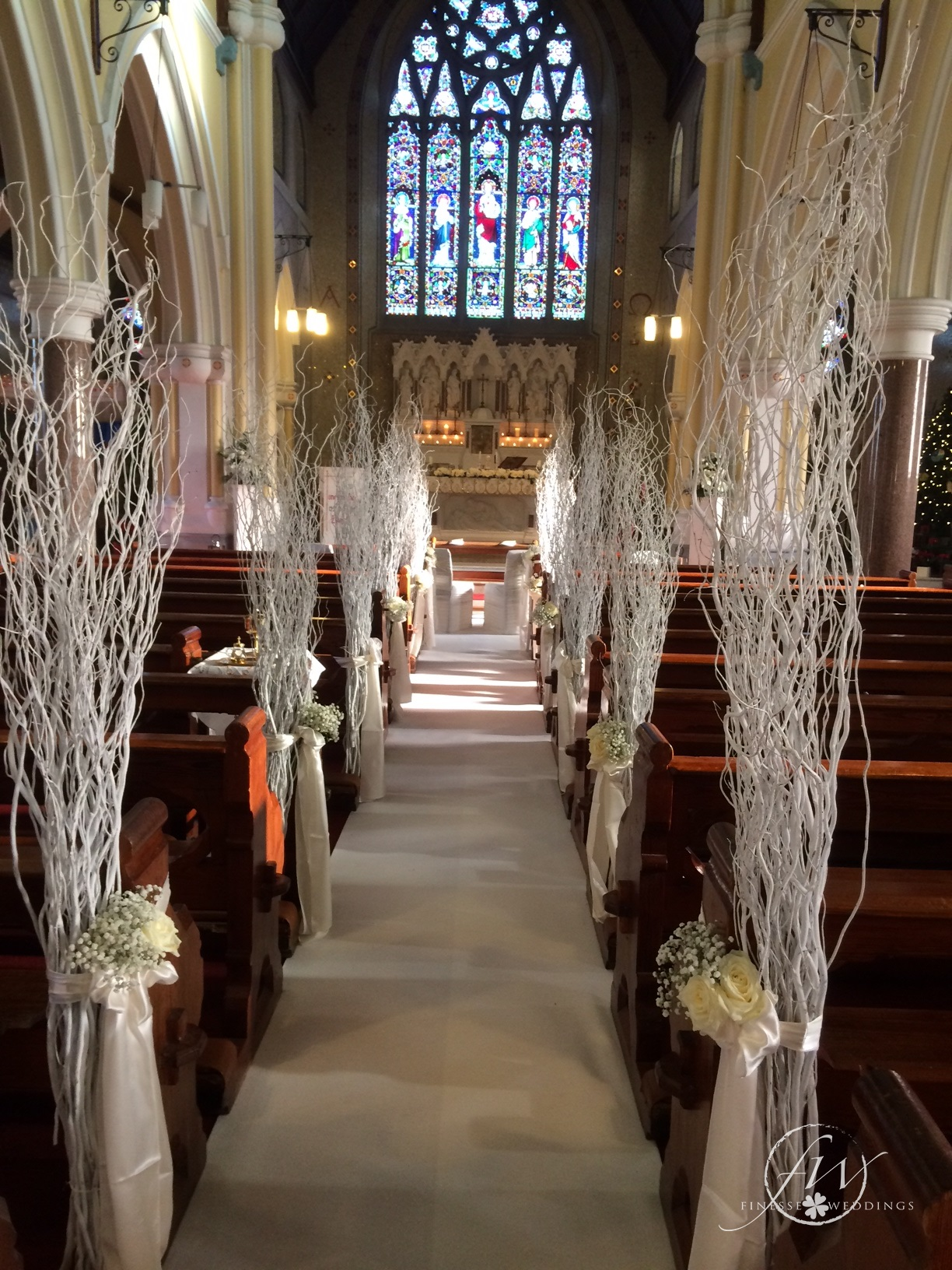 Winter Wedding Church Decor - willow pew ends with roses and gypsophilia