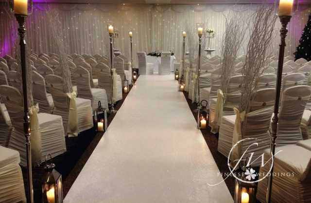 Civil ceremony decorations - aisle runner, aisle candle stands and lanterns, willow ends, chair covers, fairylight backdrop and uplighters
