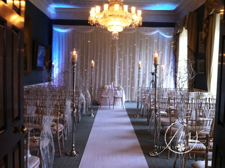 Winter themed civil ceremony at the K Club - candle aisle stands, willow aisle ends and fairylight backdrop
