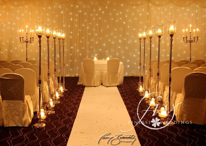 Civil ceremony decorations - fairylight backdrop, aisle stands and candle vases