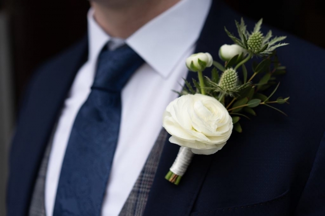 White grooms buttonhole