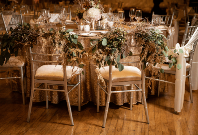 Bride and groom chairs with floral detail