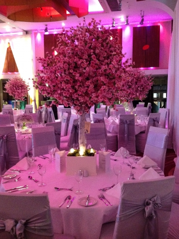 Cherry blossom trees as wedding centerpieces