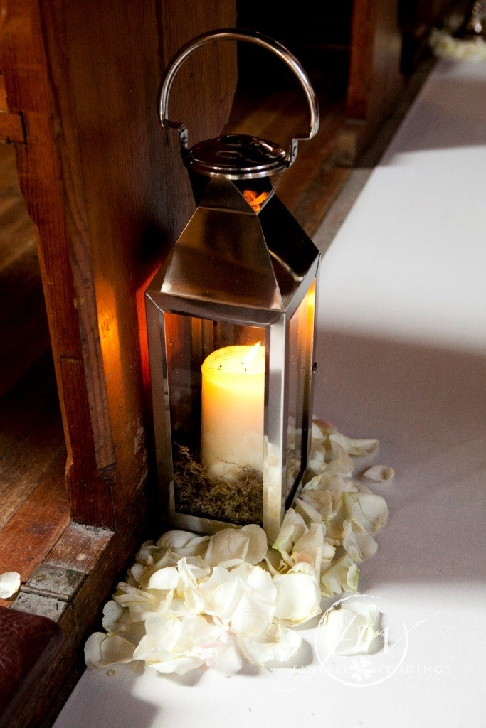 Storm lanterns with rose petals
