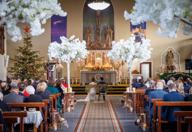 Church wedding with cherry blossom trees