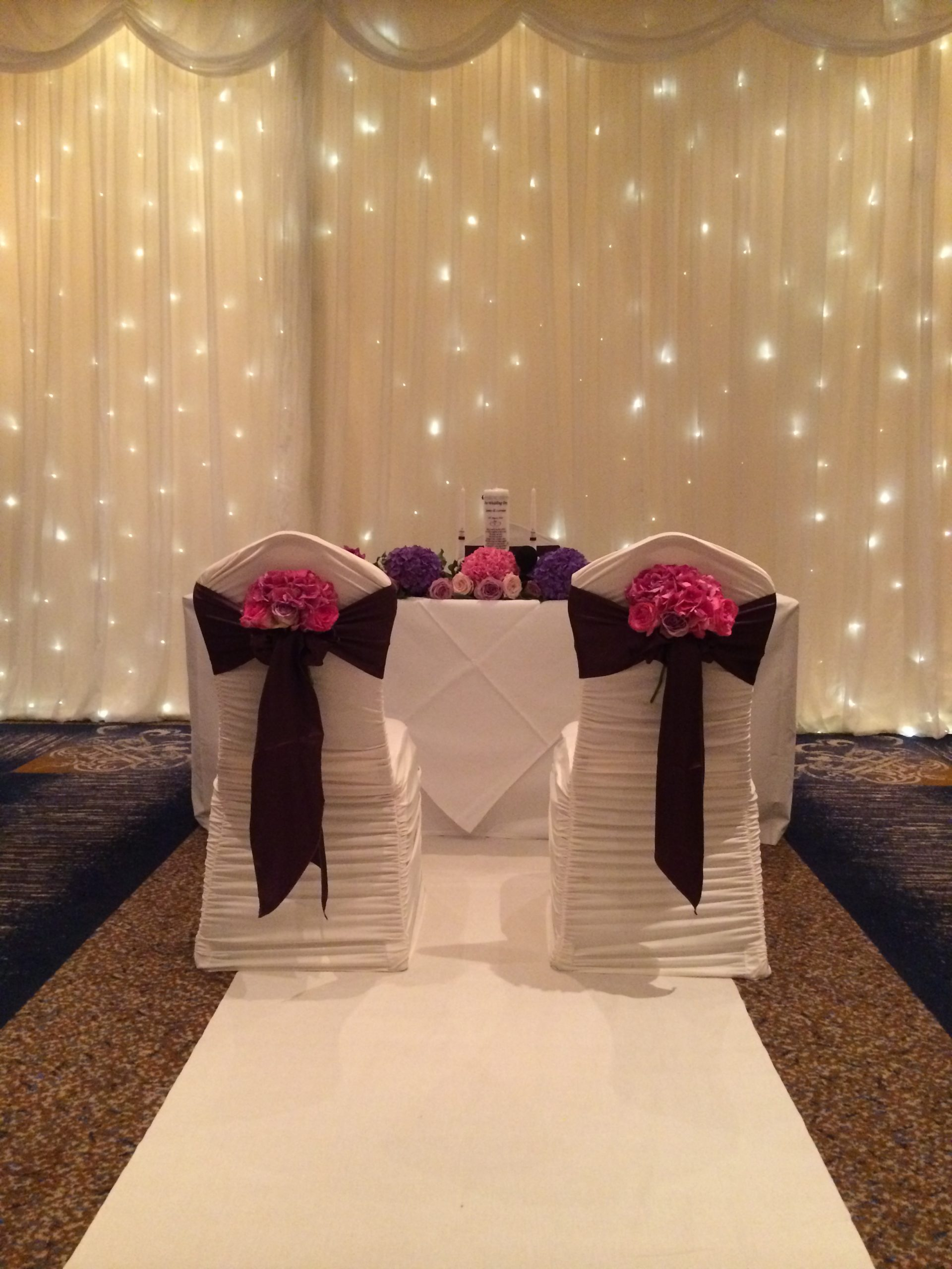 Civil ceremony - fairylight backdrop, with bride and groom chairs
