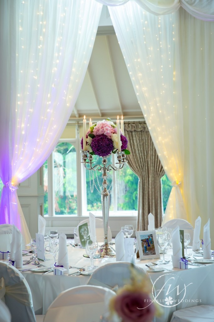 Faithlegg House Hotel candelabra with floral arrangement and fairylight draping