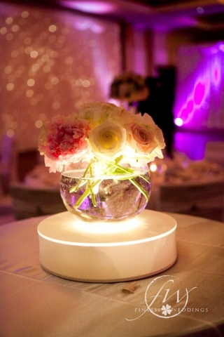 Peony roses, sweet avalanche roses and avalanche roses in fishbowl centerpieces on LED base