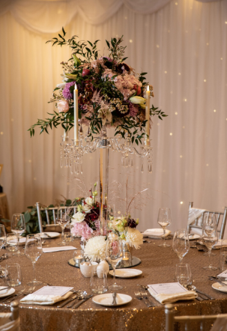 Glass candelabra centrepiece with florals for Christmas wedding