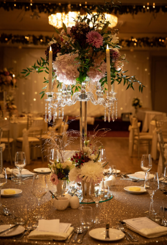 Glass candelabra with Christmas flowers