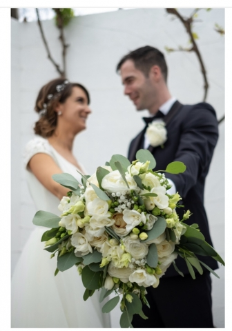 Overflowing floral bouquet in white and green