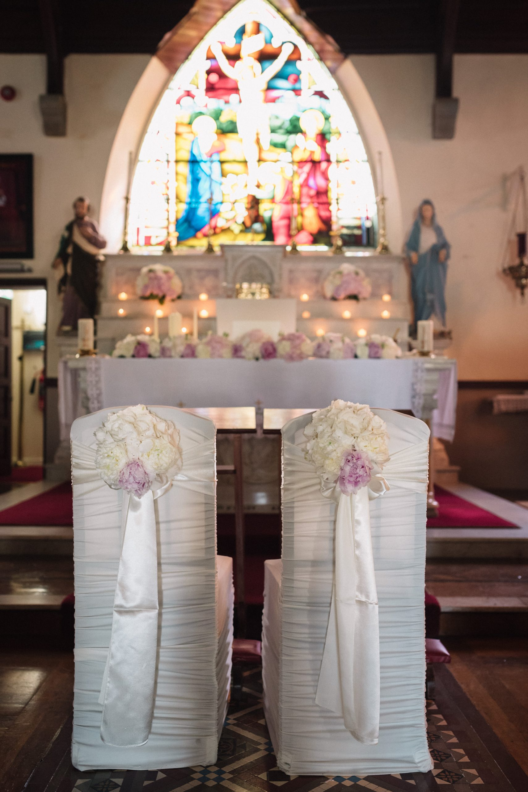 Wedding decorations - bride and groom chairs and alter arrangements