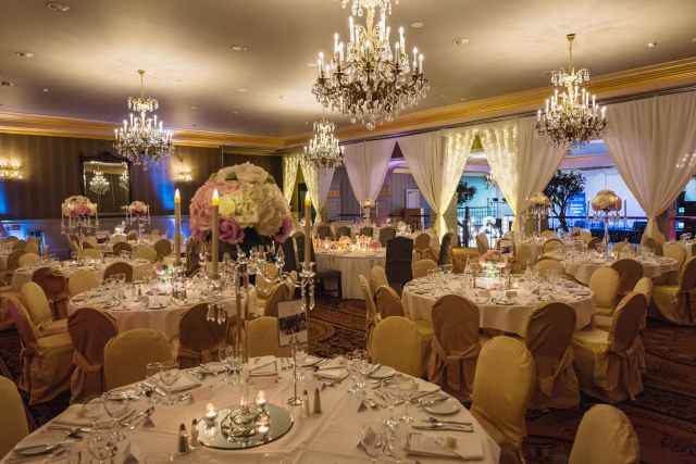 Killashee wedding - glass candelabra with floral arrangements and fairylight draping