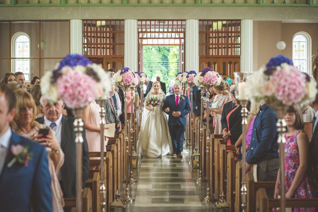 Floral dome aisle stands for church wedding