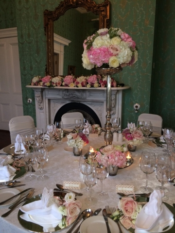 Lyrath Estate wedding decor - single stemmed silver floral stands with silver trickets