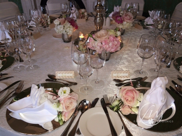 Lyrath Estate wedding table decor - floral arrangements and silver trickets
