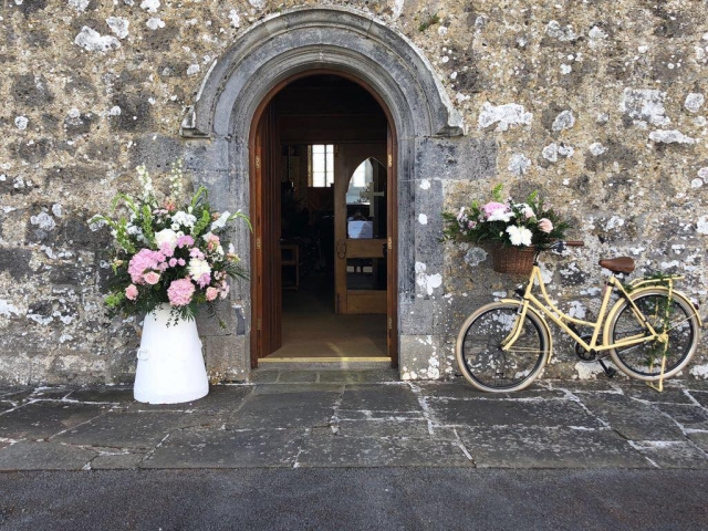 Milk churn and bicycle floral decor