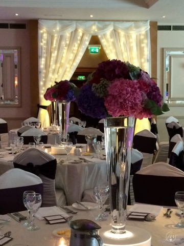 Mount Wolseley Hotel - trumpet vases with floral arrangements and fairylight door draping