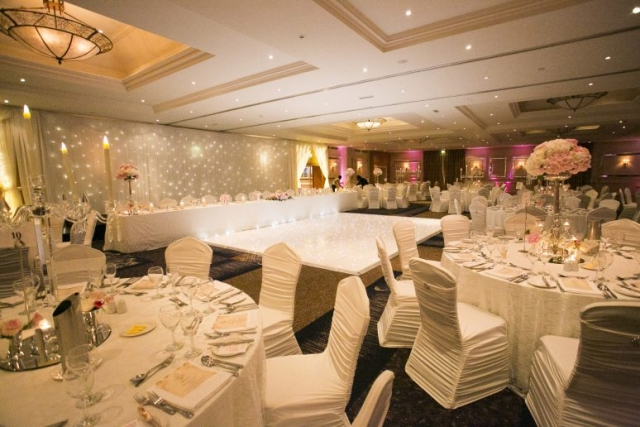 Mount Wolseley room decor - candelabra and floral centerpieces, fairylight draping, lace overlays and spandex chair covers