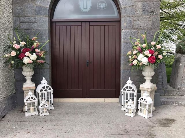 Floral urns and lanterns for church wedding