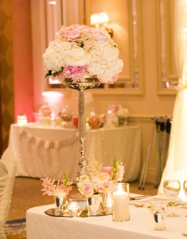 Single stemmed floral centerpiece with floral trickets and high tealights