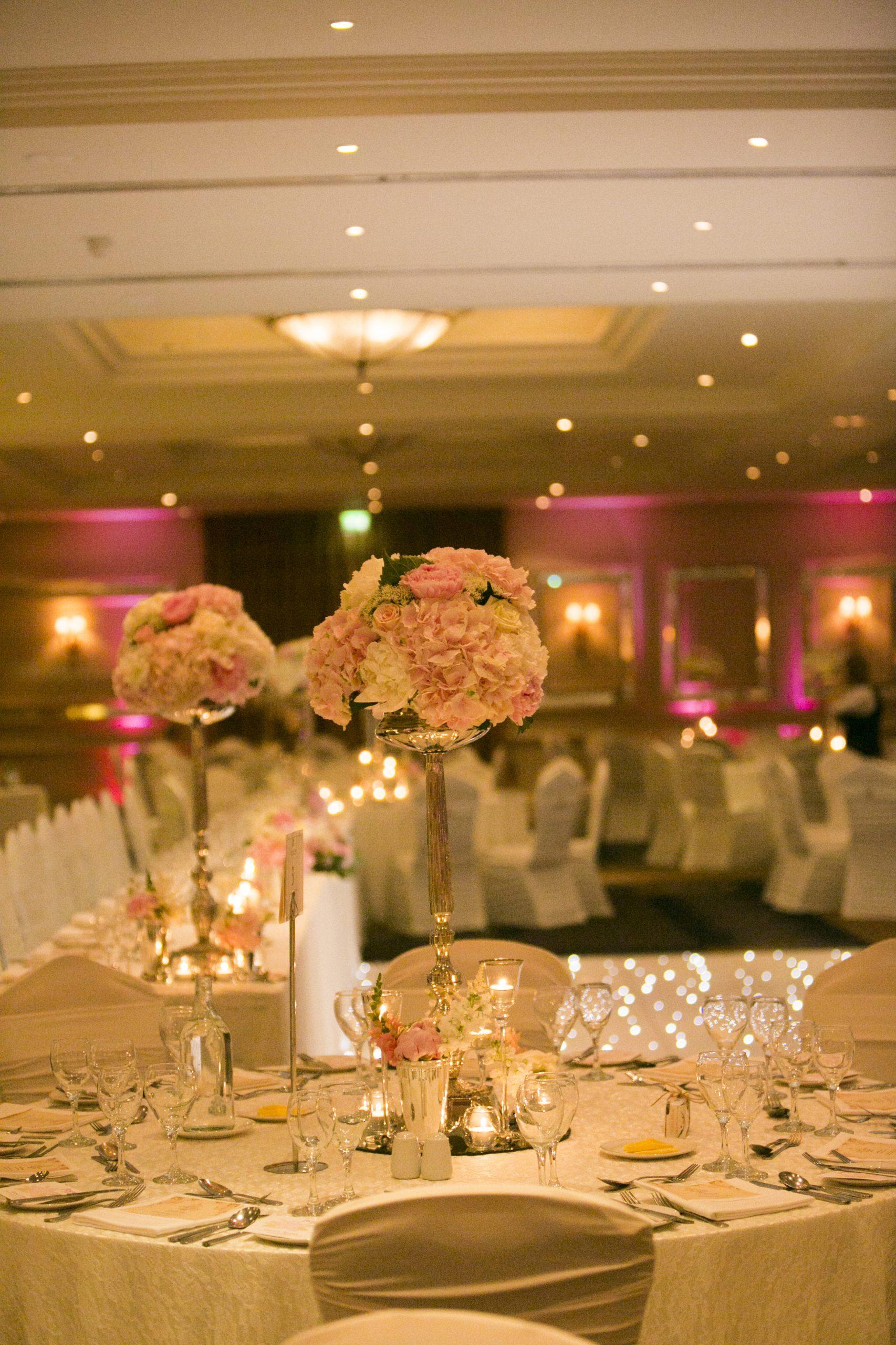 Single stemmed silver floral wedding arrangements