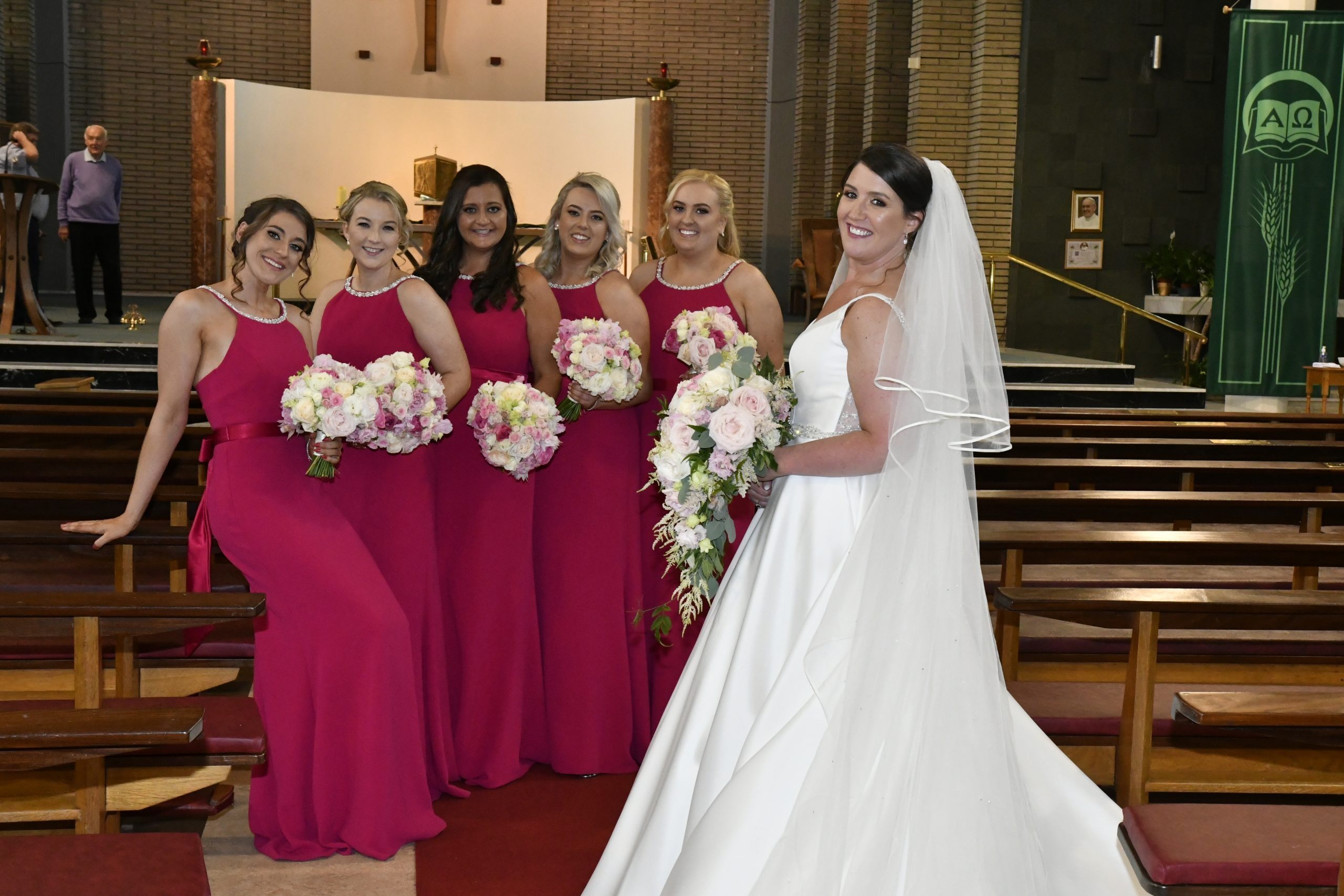 Pink and white teardrop bouquet and bridesmaids bouquets