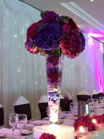 Trumpet vase centerpieces on led light base with floral arrangements