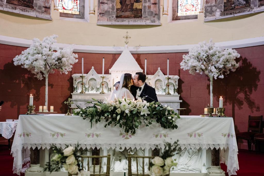Alter decor for church wedding - white cherry blossoms and flowers