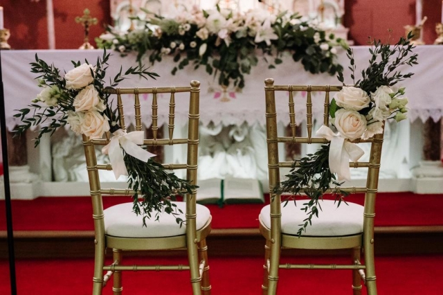 Floral details for wedding chairs