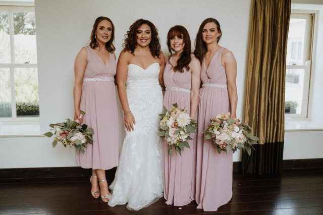Wild style bridesmaids bouquets in whites, pinks with greenery