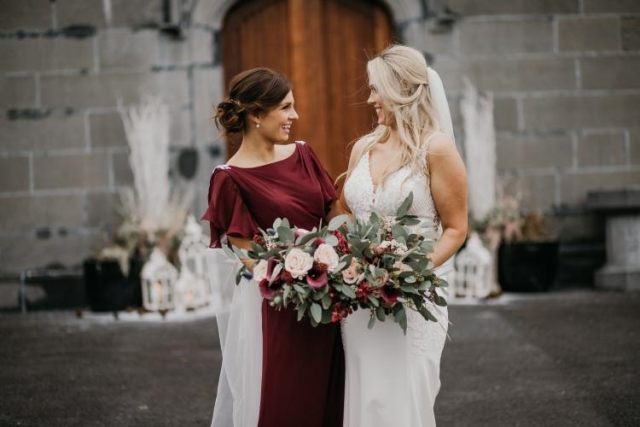 Winter wedding bouquet in wild style with roses and greenery