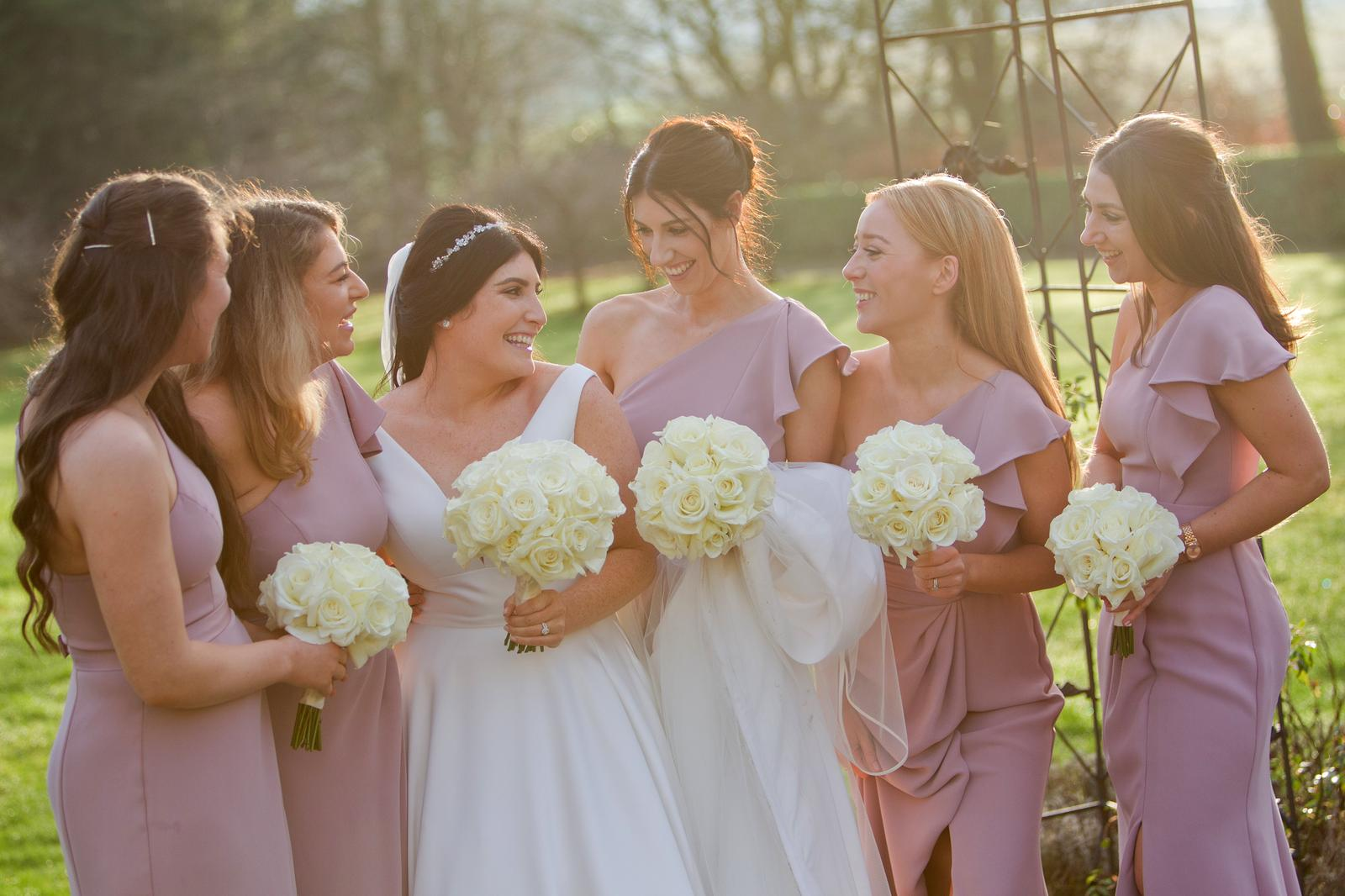 Bridal party bouquets of white roses