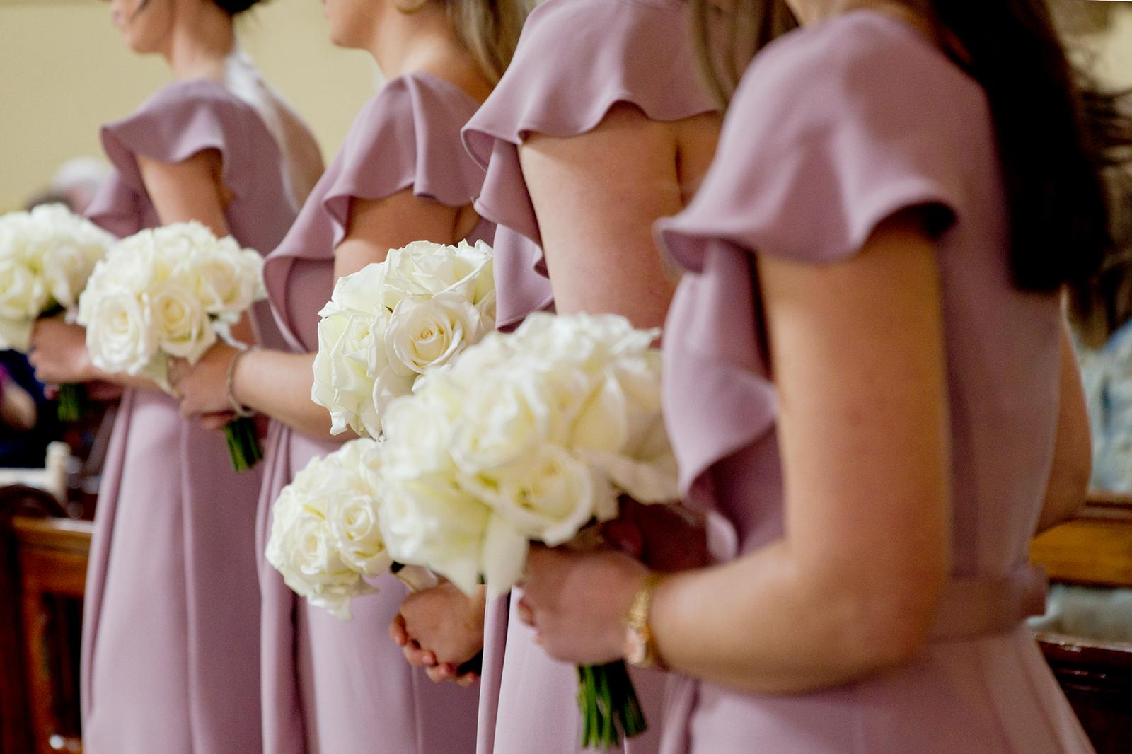 Bridesmaids bouquets of white roses