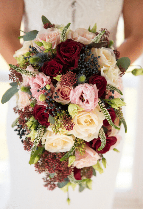 Festive December winter wedding bouquet